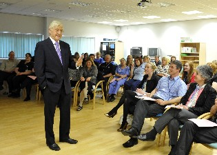 Resized Sir Michael talking to staff at Weston